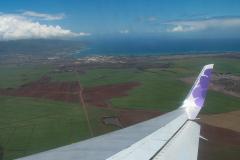 Ombord hos Hawaiian Air, på vej fra Seattles gråvejr og regn til Kahului, Maui, Hawaii