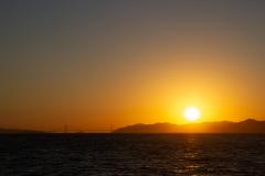Solnedgangen over San Francisco bugten, med Golden Gate i det fjerne